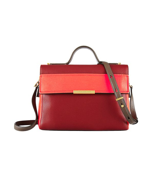 This sleek, color-blocked shoulder bag is perfect for everyday essentials. 