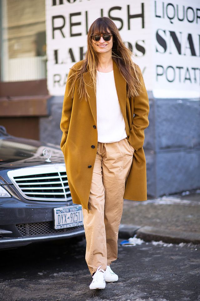 For a laidback look, style your sweater with loose trousers and crisp white sneakers.