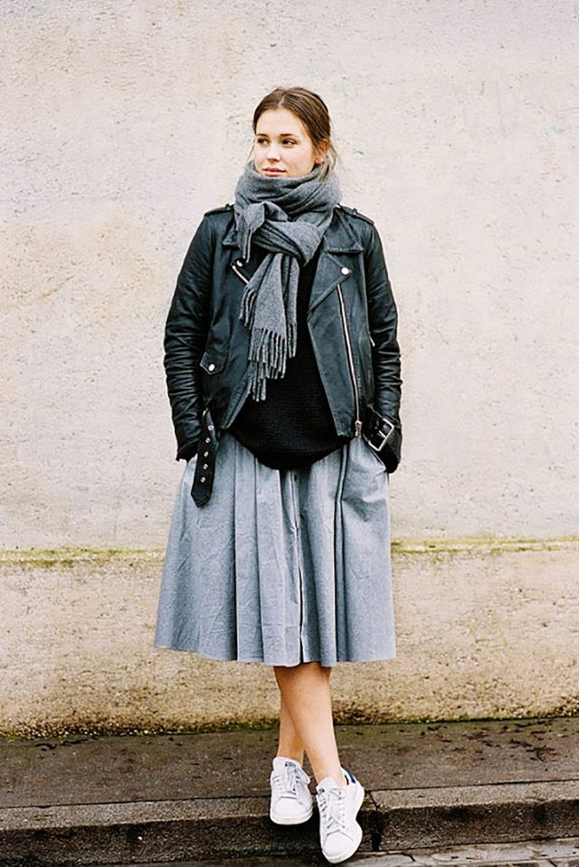 Take note how this street style savant mixes style genres with ease. Her schoolgirl-meets-biker-babe outfit is a stroke of sartorial genius.