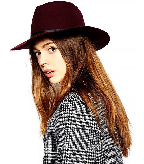 Fedoras are to Coachella as sand is to the beach. This chapeau will add an understated element of color to your outfit.  ASOS Felt Fedora Hat ($38)