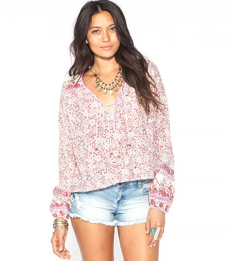 Here's why a bohemian long-sleeved top is pure genius: your arms stay protected from the sun and the breezy cut will keep you cool.