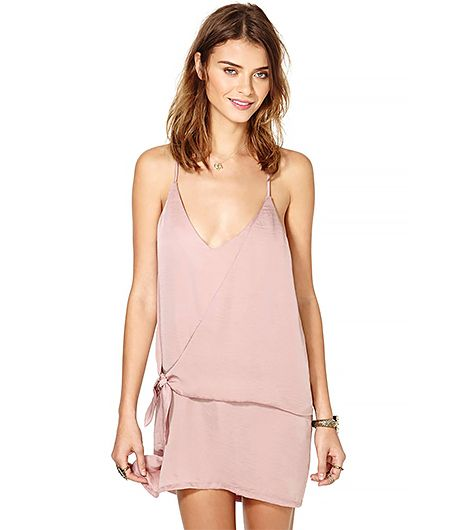 Why do we love this dress? Well there's the gorgeous dusty blush color, awesome tie detail, and keyhole back. We could go on, but we think you get the point.