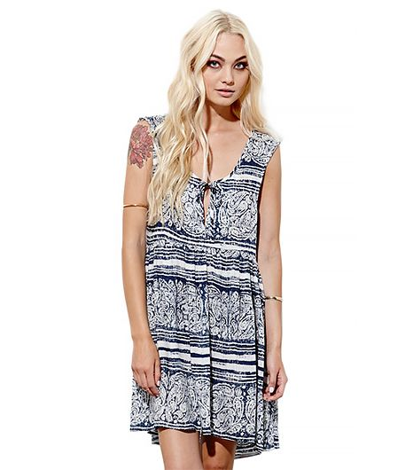 Sun-bleached print dresses were made for swaying to your favorite band.