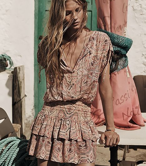 Feminine yet bohemian, this darling lightweight dress is ideal for braving the hot desert sun.