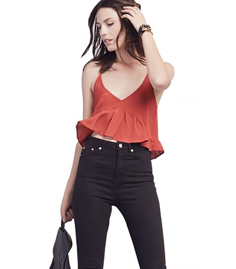 Throw on this flirty crop top with jean shorts and a pair of ankle boots for a coquette in cutoffs vibe.