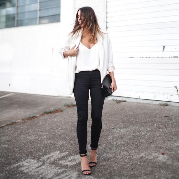 Modernlegacy is wearing: Zara blazer, Camilla and Marc tank top, Lee jeans, Proenza Schouler bag, Alexander Wang heels.  Get The Look:  Zara Fabric Blazer ($100) in Off-White  See more...