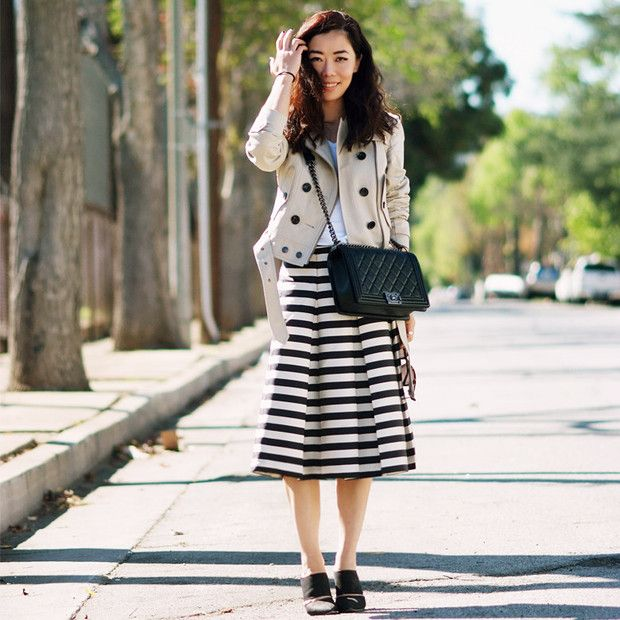 Halliedaily is wearing: Burberry Brit jacket, Alexander Wang heels, Chanel bag.  Get The Look:  Pim + Larkin Striped Pleated Skirt ($50) in Black/White  See more ways to wear striped...
