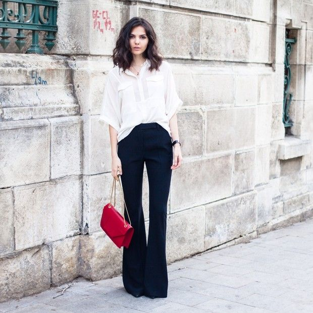 Doinaciobanu is wearing: The Addison Story shirt, Alexander McQueen pants, Yves Saint Laurent bag.  Get The Look:  Rebecca Minkoff Mini Wallet on a Chain ($89) in Hot Red  See more ways to...