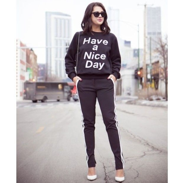 Jenagambaccini is wearing: Dion Lee pants, Ashish sweatshirt, Schutz heels, Zac Posen x Illesteva sunglasses.