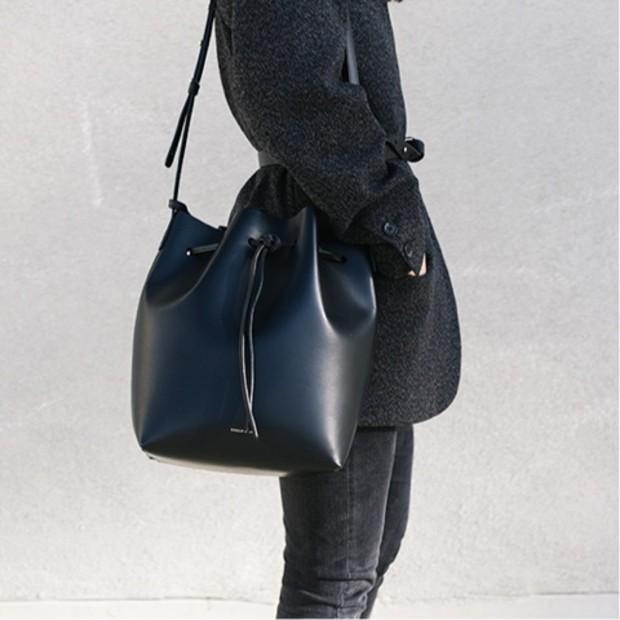 Andyheart is wearing: Mansur Gavriel bag, Isabel Marant coat, Acne pants.  Get The Look:  Calvin Klein Medium Drawstring Bucket Bag ($148)  See more ways to wear bucket bags on Pose.com.