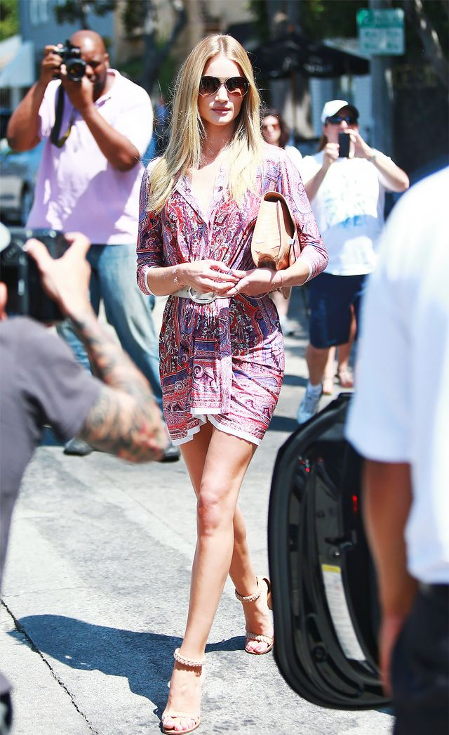 On Huntington-Whiteley: Burberry Prorsum Half-Frame Aviator Sunglasses ($200); Isabel Marant dress and belt; Chloe sandals.