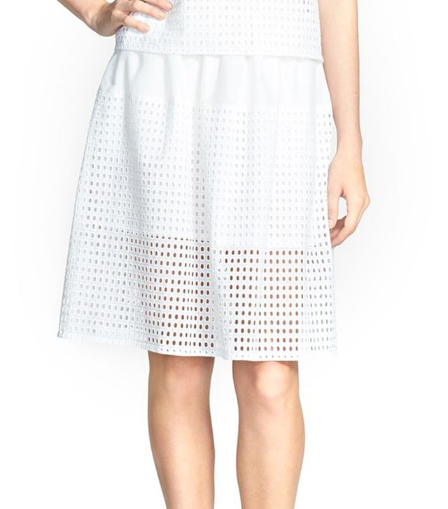 The sheer eyelet panel sings of spring.