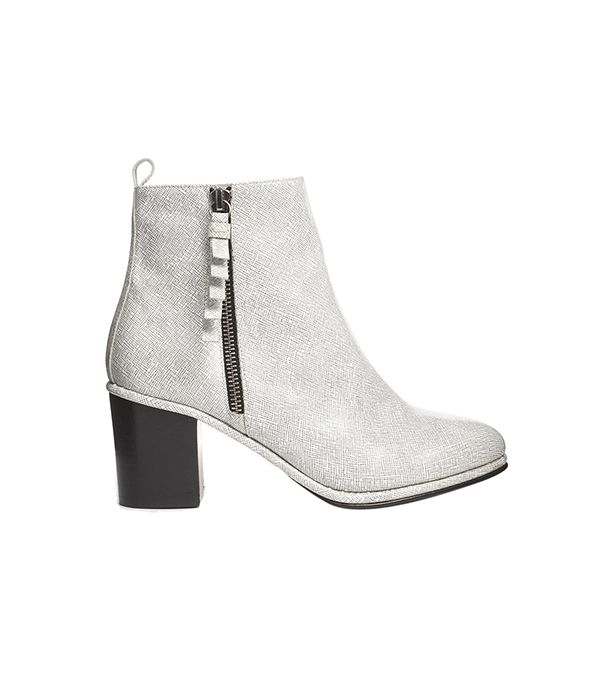 Opening Ceremony Shirley Zip Side Heeled Ankle Boots ($546) in White/Black  Embrace your bold side with these statement boots.