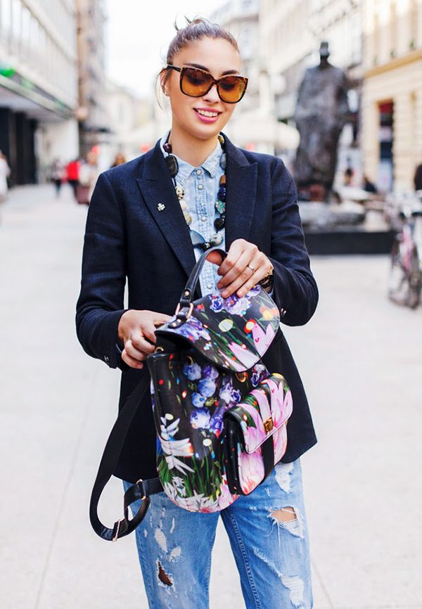 Style Tip: Pair a vibrant, floral-print backpack with subdued staples like a blazer, button-down shirt, and jeans.