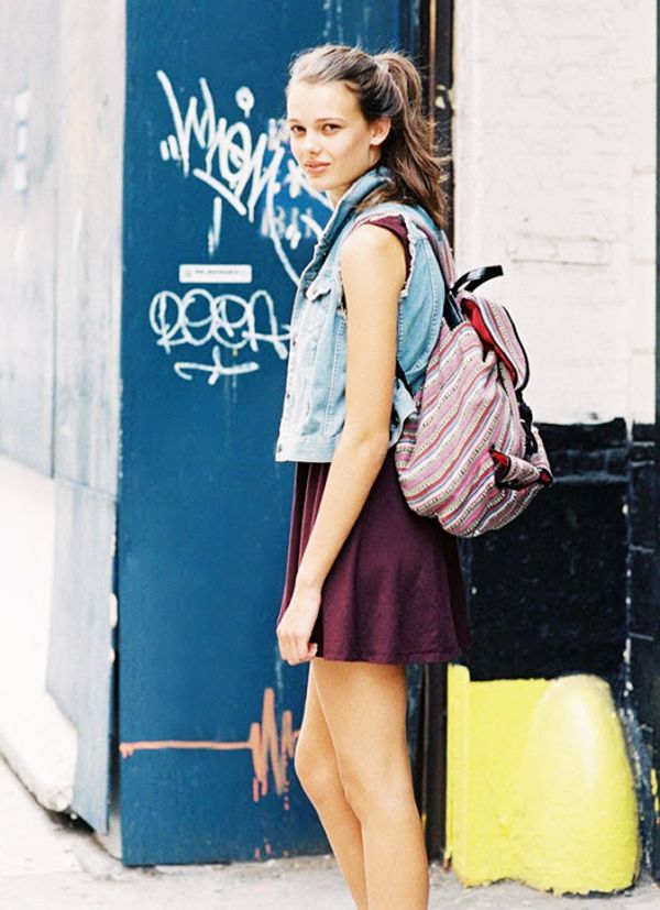 Style Tip: Try mixing your backpack with playful elements, like a high ponytail and a denim vest.