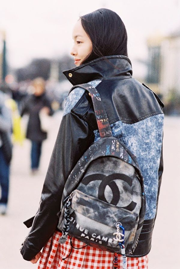 Style Tip: A graffiti-print backpack is the perfect dose of grunge your outfit has been looking for. Thank you, Chanel.