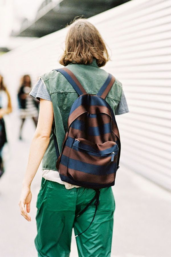 Style Tip: Next time you rock a monochrome ensemble, break it up with a contrasting, striped backpack.