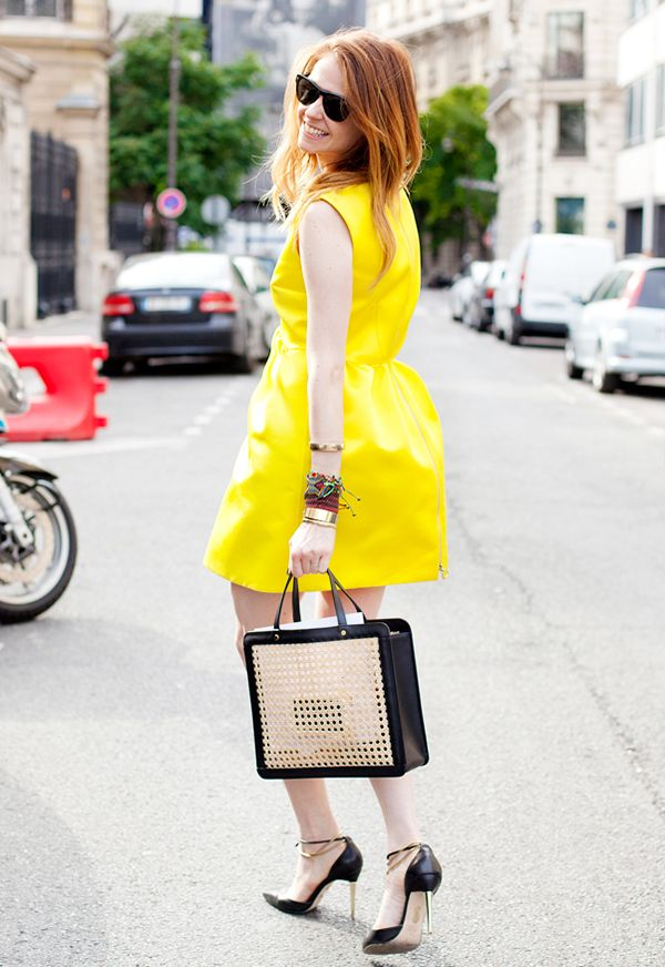 Style a striking yellow dress with festive bracelets and your go-to tote for the perfect Saturday look.
