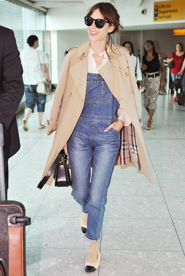 Style Tip: Wear your overalls to the airport with a trench coat, white blouse, and feminine flats.