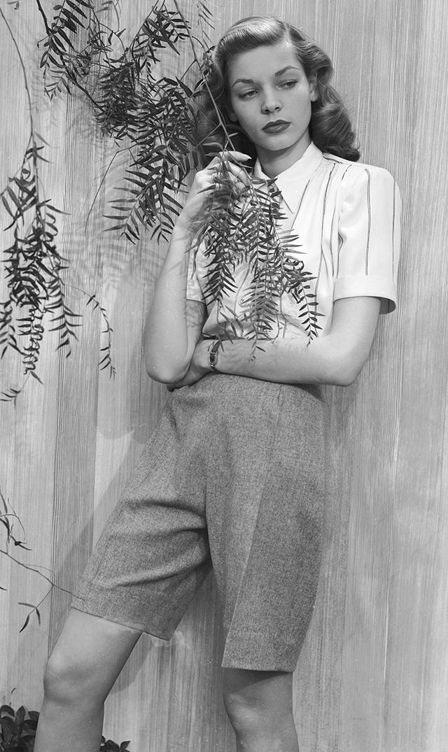 Lauren Bacall  Attention: tomboys everywhere, take note! This insanely chic masculine-inspired look is perfectly styled. From the polished up-do to the short-sleeve button-down shirt to the...