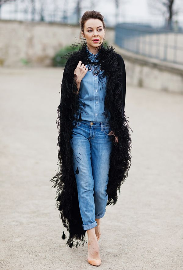 How to dress up your denim tuxedo? With a feather-embellished cape, of course!
