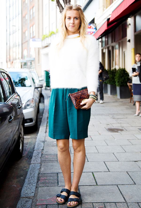 We adore the contrast of fancy silk shorts and casual Birkenstocks.
