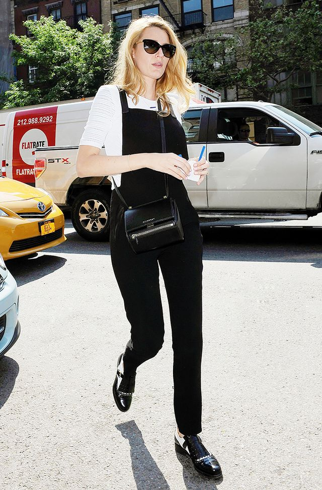 A cool black jumpsuit or overalls is an on-trend choice for most creative offices. Wear it with a neutral-colored top and accessories for the most office-appropriate look.