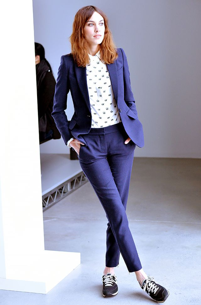 Want to look like the coolest girl at the office? Pair a slim pantsuit with sporty trainers. For the most flattering effect, make sure your pants are slightly cropped at the ankle.