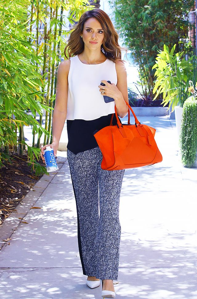 If your office is typically on the conservative side, keep your Friday wardrobe ultra-professional with printed slacks and pumps. Color-blocking and bright accessories add interest.