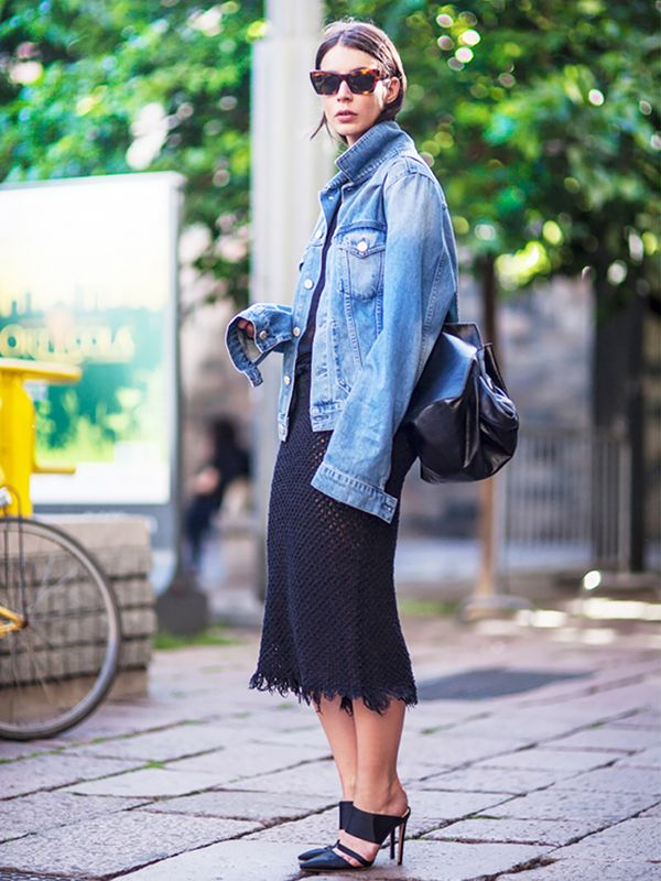 We love the playful touch that too-long sleeves add to this stylish outfit. ?On Irina Lakicevic of A Portable Package: Acne Studios denim jacket; Isabel Marant Etoile skirt; Altuzarra Mules...