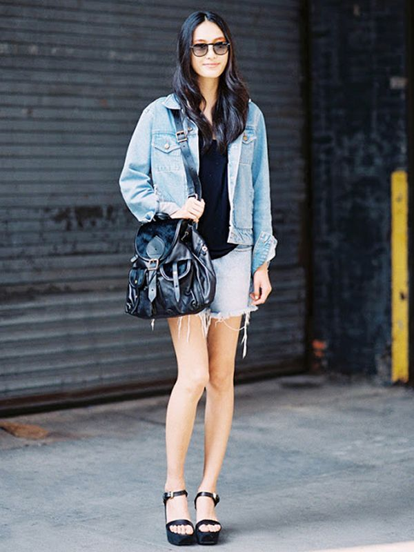 Denim jacket + cut-off shorts + black accents = one awesome outfit.