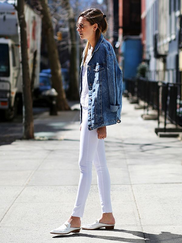 A boyfriend jean jacket in the perfect shade of blue goes flawlessly with an otherwise all-white ensemble. ?On Danielle Bernstein of We Wore What: Zara Oversize Denim Jacket ($70); Pixie Market...