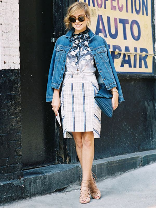 Drape a boyfriend jean jacket over your shoulders fashion-editor-style for a poised look. ?On Kelly Framel: Rebecca Minkoff jacket and skirt; Aquazzura sandals.