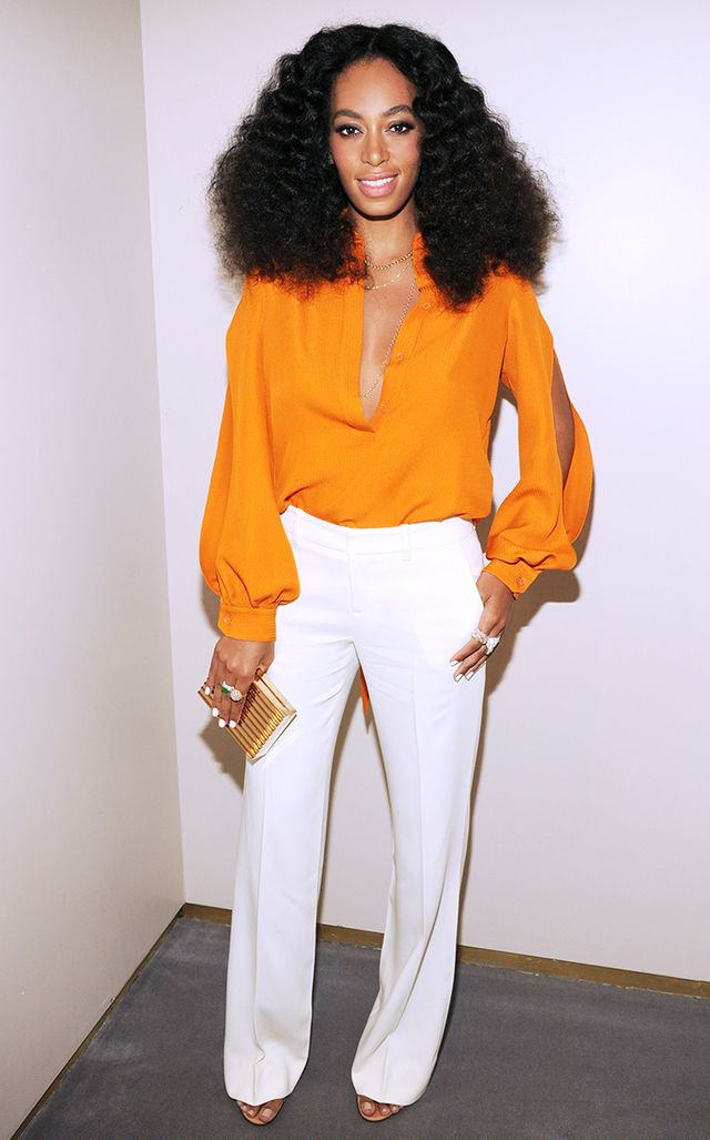 For the one-year anniversary of Gucci's Chime for Change organization, Knowles reached for a head-to-toe look from the Italian fashion house—a vivid orange blouse ($1,150) and...