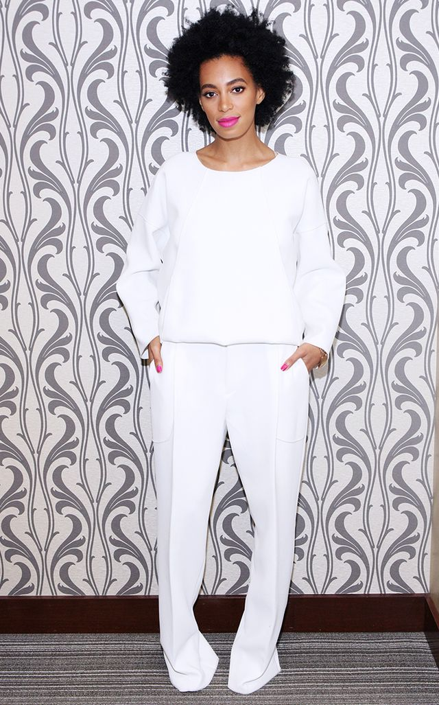 All-white done right: Knowles perfectly illustrates how to pull off a monochromatic look in a slouchy blouse-and-pant ensemble, set off by her matching poppy pink nails and lips.