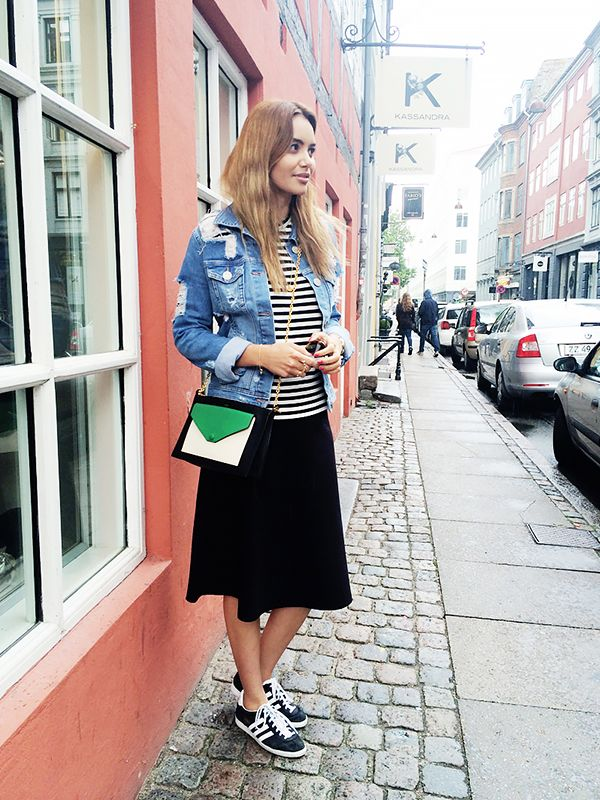 On Funda Christophersen of By Funda: Gestuz Pocca Jacket ($91); Play Comme Des Garçons Stripe Sweater ($390); COS Flared Hem Skirt ($101); Adidas sneakers; Celine bag.