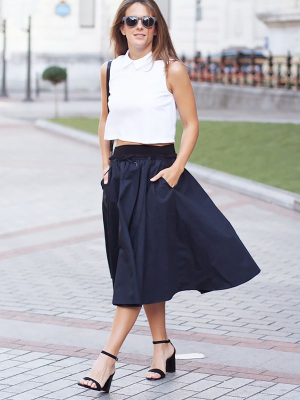 On Izortze Setien of Clochet: Suite Blanco Textured Short Sleeve Top ($15); Zara skirt and sandals; COS bag.