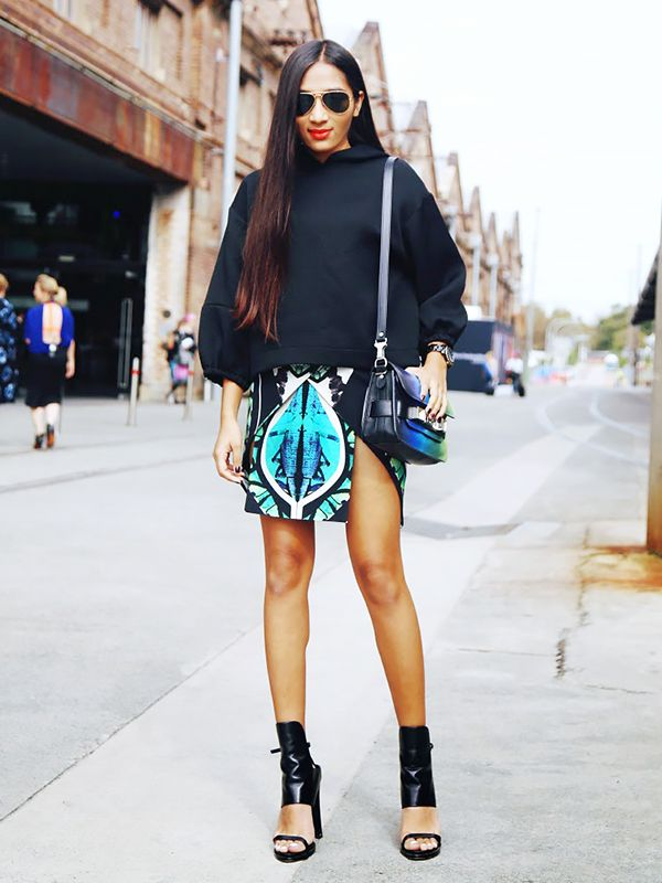 On Tasfia Reza of Inside In, Inside Out: Stolen Girlfriends Club top; Michael Lo Sordo skirt; Alexander Wang shoes; Proenza Schouler Medium Leather Bag ($1370); Ray-Ban RB3025 Aviators ($161).