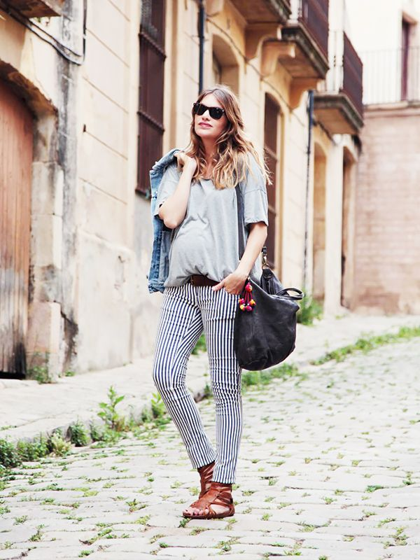 On Mireia Oller of My Daily Style: Levi's Denim Jacket ($94); Mamalicious pants; Bronx Sandals ($82) in Brown; Brussosa Backroom Bag ($265) in Black.
