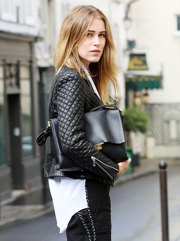 On Annabel Rosendahl of Annabel Rosendahl: Barbara Bui Biker Jacket ($2033); Helmut Lang top; Isabel Marant Brodie Leather Shorts ($1704); Celine bag.