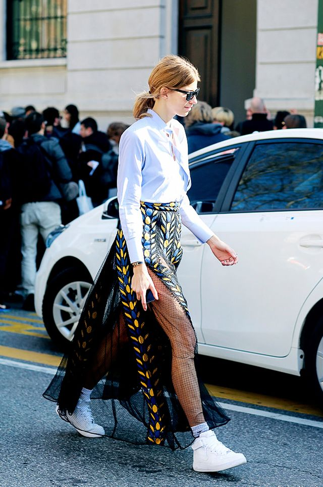 Tip 7: Bring a sheer maxi skirt down to earth with tennis shoes.