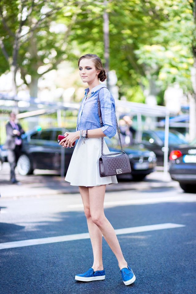 Tip: Give a feminine tomboy spin to your look with a miniskirt and slip-on sneakers: