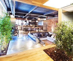 An Industrial Loft Renovation Lets the Outdoors In